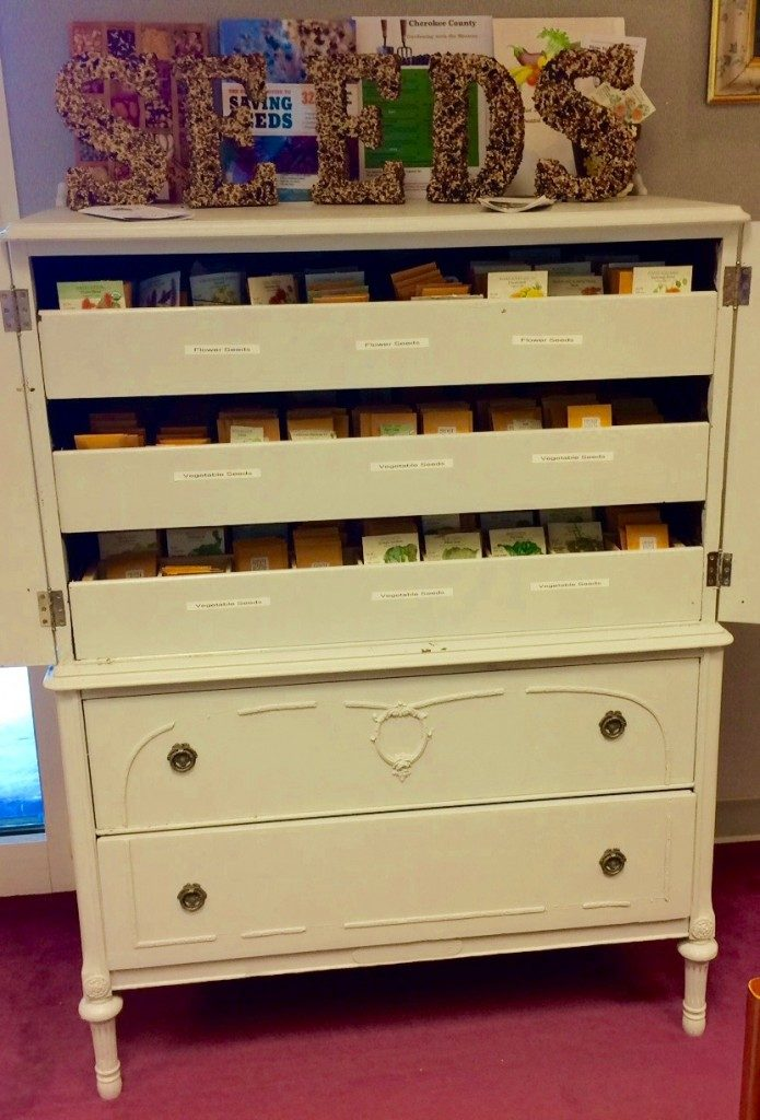 The seed library is actually a re-purposed antique dresser customized by Cherokee Master Gardener's very own, Gerald Phillips.