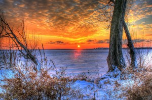 Gfp-wisconsin-madison-sunset-over-the-ice-between-trees