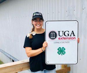 Shelby holding UGA sign