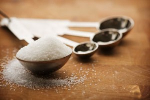 Measuring spoons filled with sugar