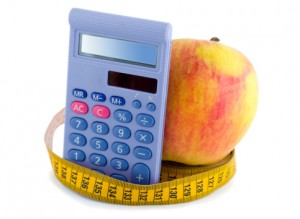 Apple,measuring tape and calculator