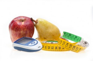 fruit, measuring tape and glucometer
