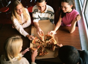 Students splitting a pizza