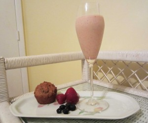 smoothie in stemware with muffin and fruit