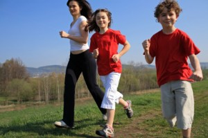 Kids run with mom outside