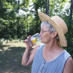 lady drinking water outdoors