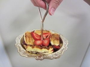 Strawberry panini on small, silver serving plate