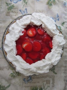 A whole strawberry creme pie with whipped topping