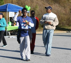 Walk Star Betty Hawthorne, of Bibb County, at the completion of her first 5K.