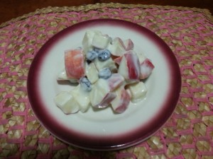 Apple salad with yogurt on a plate