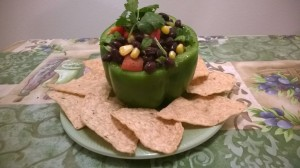 Black bean salsa in a bell pepper with chips