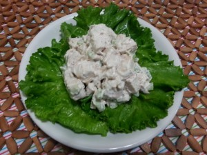 Chicken salad on a lettuce leaf on a plate