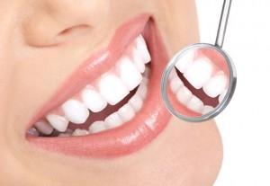 Close-up of woman's mouth with dentist's mirror