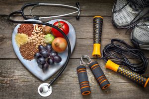 Healthy lifestyle concept with diet and fitness on wooden boards